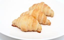 Partes novas do Croissant 3 de placa branca limpa Imagem de Stock
