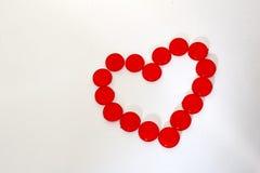 Partes plásticas do círculo na forma do coração Fotografia de Stock