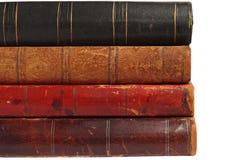 Partes posteriores de cuatro libros viejos Imagen de archivo libre de regalías