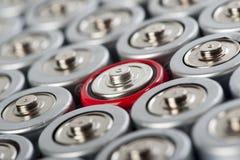 Partes superiores das baterias macro com vermelho um do contraste Fotografia de Stock Royalty Free