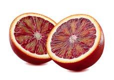 2 partes vermelhas da laranja pigmentada meias isoladas no fundo branco Fotografia de Stock