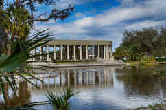 New Orleans City Park. The Parthanon is the most recognizable peice of architecture in New Orlean's City Park.  It sits across a placid lake and is flanked by Stock Photography