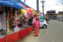Parthasarathy temple , Aranmula. ARANMULA,INDIA- July 24: Unidentified street toys seller standing in front of his shop on July 24, 2015 at Aranmula royalty free stock photography