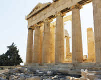 Parthenon columns warm sun light Athens. Warm sun light passing among the columns of a famous ancient temple in Athens, Greece: Parthenon stock image