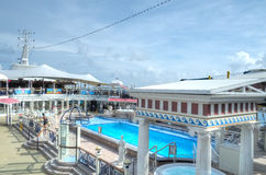 Parthenon Pool, Super Star Virgo. The pool on the upmost deck of the Super Star Virgo cruise ship Royalty Free Stock Images