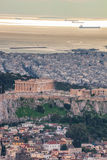 Parthenon temple on the Acropolis against sea in Athens, Greece Stock Photos