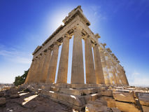 Parthenon temple in Athens, Greece. Parthenon temple restoration back lit by the sun Royalty Free Stock Photography
