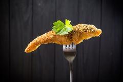 Parti dei pesci fritti su una forcella Fotografie Stock