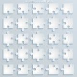 Parti dei puzzle di carta. Immagini Stock