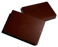 Parti del cioccolato isolate su bianco Fotografie Stock