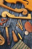 Parti del violino su fondo di legno Fotografia Stock Libera da Diritti
