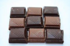 Parti della barra di cioccolato Immagini Stock