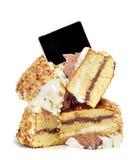 Parti della torta e del contrassegno in bianco della lavagna Fotografia Stock