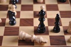 Parti di scacchi sulla scheda Immagine Stock Libera da Diritti