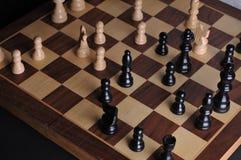 Parti di scacchi sulla scheda Immagini Stock