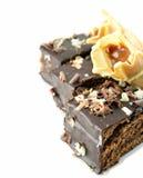 Parti di una torta e delle pasticcerie isolate Fotografia Stock