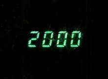 2000 parti digital verde horizontal del polvo del reloj de la exhibición del milenio Foto de archivo