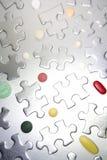 Parti e pillole di puzzle Fotografie Stock Libere da Diritti