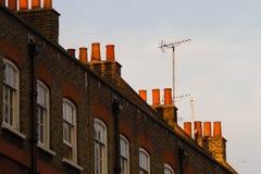 Parti superiori di camino delle case urbane Immagini Stock Libere da Diritti