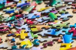 Parti variopinte di puzzle Immagini Stock