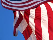 The American Flag Blowing in the Wind stock photos