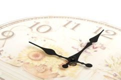 Partial frame photo of a clock without face cover. Showing nine o`clock against a white backdrop royalty free stock photo