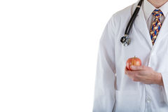 Partial front view of doctor holding apple on white background Stock Photography