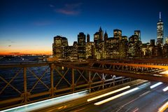 Partial New York skyline at sunset from the Brooklyn Bridge. Stock Image