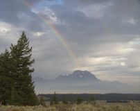 Partial rainbow over Mt. Moran on a cloudy day Royalty Free Stock Photos