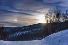 Partial rainbow over ski trail Royalty Free Stock Image