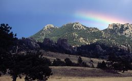 Partial Rainbow, Vedauwoo Recreation Area, Wyoming. A partial, flattened rainbow arcs over the Vedauwoo area Stock Photography