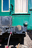 Partial rear view of an old passenger railroad carriage on rails Stock Photo