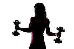 Partial Silhouette of a Fitness Trainer Holding Weights Stock Photo