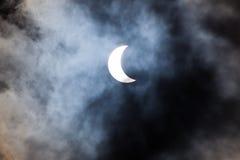 Partial solar eclipse through clouds. Partial solar eclipse viewed through clouds Stock Images
