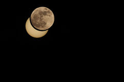 Partial solar eclipse moon photomontage Royalty Free Stock Photography