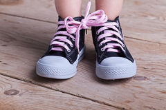 Partial success - child with two shoes tied Stock Photography