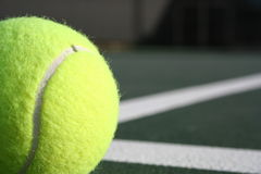Partial Tennis Shot. Partial shot of a tennis ball with court lines in the background Royalty Free Stock Images