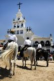 El Rocio festivity. Partial view of the beautiful church of El Rocio in Spain, where a festivity is taking place Stock Photo