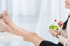 partial view of businesswoman with take away food at workplace stock photo
