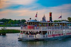 Partial view of Cinderella`s Castle and Disney Ferry boat on colorful sunset bakcground at Walt Disney World  area  2 royalty free stock image