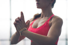 Partial view closeup of fit womans hands in yoga pose Royalty Free Stock Images