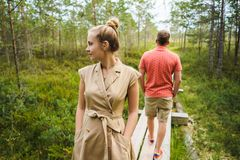 partial view of couple in love on wooden bridge with green plants royalty free stock image