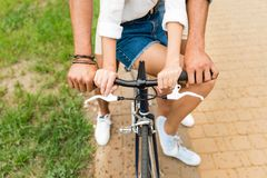 partial view of couple riding bicycle together royalty free stock image