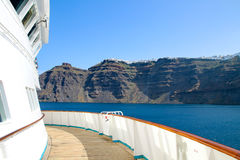 Partial view of a cruise ship with caldeira of Santorin in the b royalty free stock photography