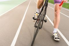 Partial view of cyclist riding bicycle on cycle. Race track Stock Photos