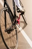 Partial view of cyclist riding bicycle on cycle. Race track Royalty Free Stock Photography