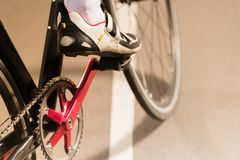 Partial view of cyclist riding bicycle on cycle. Race track Stock Photography
