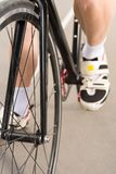 Partial view of cyclist riding bicycle on cycle. Race track Royalty Free Stock Images
