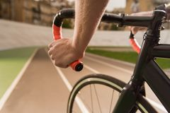 Partial view of cyclist riding bicycle during race on cycle. Race track Royalty Free Stock Images