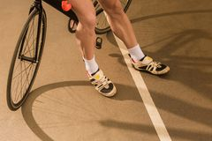 Partial view of cyclist standing near bicycle on cycle. Race track Royalty Free Stock Photos